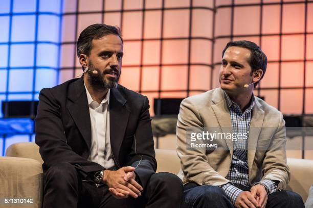 Jose Neves chief executive officer of Farfetch left speaks as Jason Robins cofounder and chief executive officer of DraftKings Inc listens during the...