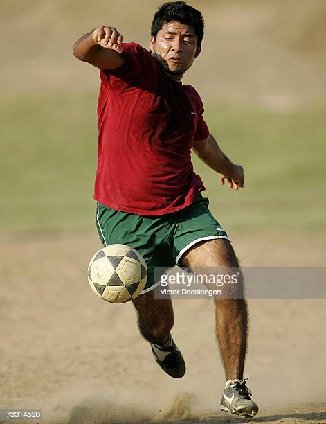 Jose of Mexico aka 'Mexico' to his soccer mates lunges to play the ball during a pickup soccer match at Pan Pacific Park in the Fairfax District of...
