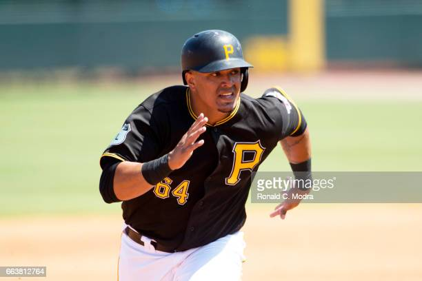 Jose Osuna of the Pittsburgh Pirates runs to third base during a spring training game against the Tampa Bay Rays at LECOM Park on March 21 2017 in...