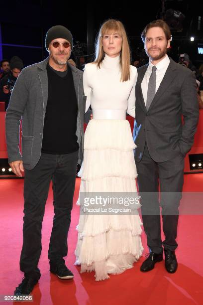 Jose Padilha Rosamund Pike and Daniel Bruehl attend the '7 Days in Entebbe' premiere during the 68th Berlinale International Film Festival Berlin at...