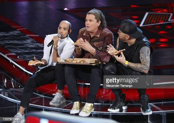 Jose Palacio Otero Carlos Vives and Wisin are seen during Telemundo's La Voz blind auditions Week 6 at Cisneros Studios on February 23 2020 in Miami...