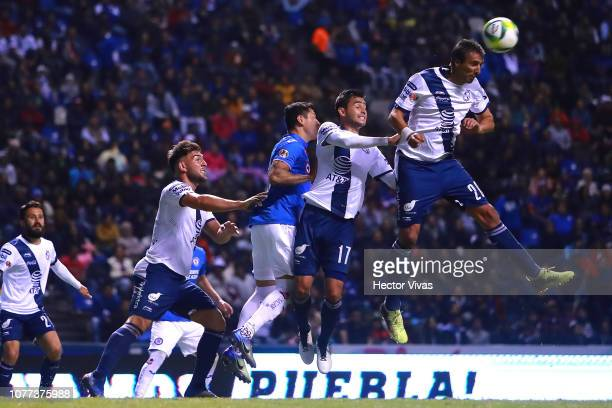 Jose Pallas of Puebla heads the ball during the 1st round match between Puebla and Cruz Azul as part of the Torneo Clausura 2019 Liga MX at...