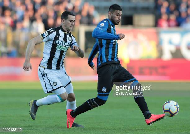 Jose Palomino of Atalanta BC is challenged by Kevin Lasagna of Udinese Calcio during the Serie A match between Atalanta BC and Udinese at Stadio...