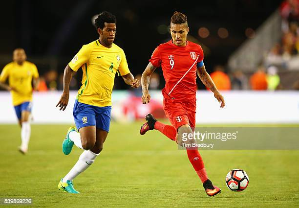 Jose Paolo Guerrero of Peru dribbles against Gil of Brazil in the second half during a 2016 Copa America Centenario Group B match at Gillette Stadium...