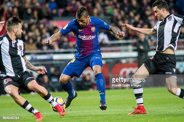 Jose Paulo Bezerra Maciel Junior Paulinho of FC Barcelona competes for the ball with Antonio Manuel Luna Rodriguez and Sergio Postigo Redondo of...