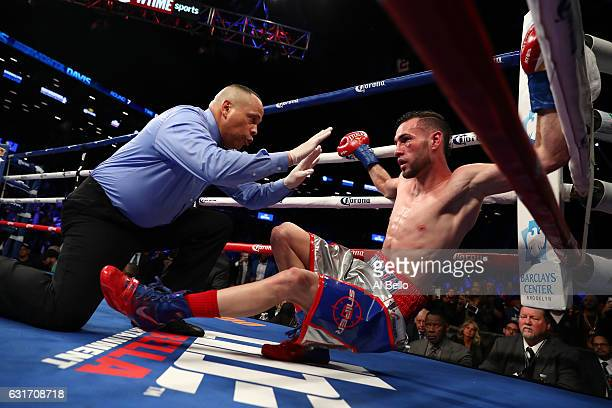 Jose Pedraza is knocked down and loses via TKO against Gervonta Davis in the seventh round during their IBF Junior Lightweight Championship at the...