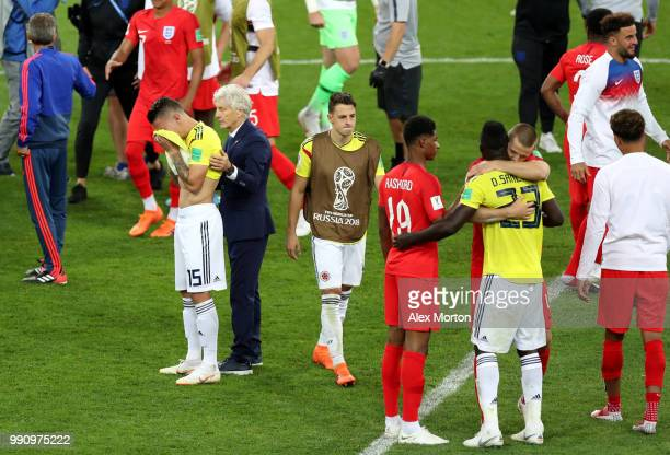 Jose Pekerman Head coach of Colombia embraces Mateus Uribe of Colombia after defeat after the 2018 FIFA World Cup Russia Round of 16 match between...