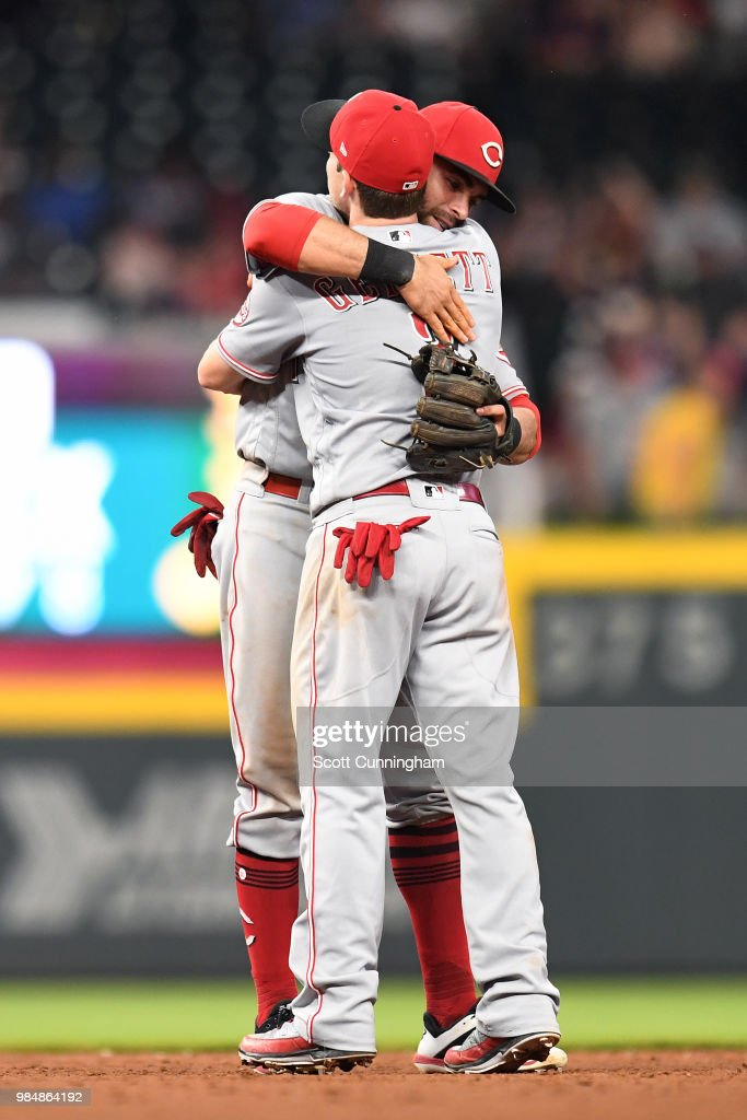 Jose Peraza #9 and Scooter Gennett #3 of the Cincinnati Reds celebrate after the game against the Atlanta Braves at SunTrust Park on June 26, 2018 in Atlanta, Georgia.