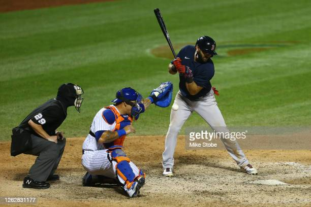 Jose Peraza of the Boston Red Sox is hit by a pitch to force in a run in the ninth inning against the New York Mets at Citi Field on July 30, 2020 in...