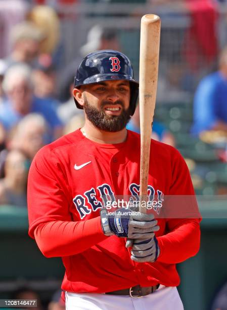 Jose Peraza of the Boston Red Sox looks at his bat prior to batting against the Tampa Bay Rays on February 22, 2020 at JetBlue Park in Fort Myers,...