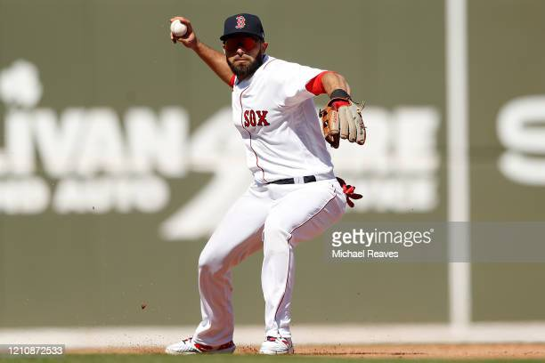 Jose Peraza of the Boston Red Sox throws out a runner against the New York Yankees during the second inning of a Grapefruit League spring training...