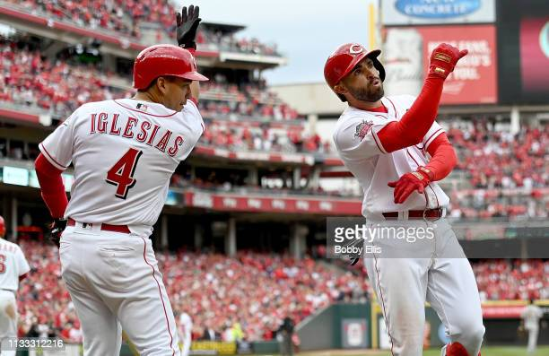 Jose Peraza of the Cincinnati Reds and Jose Iglesias of the Cincinnati Reds celebrate after Peraza hit a three run home run during the seventh inning...