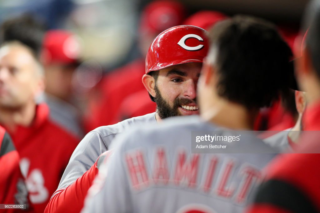 Jose Peraza #9 of the Cincinnati Reds celebrates a home run in the ninth inning against the Minnesota Twins at Target Field on April 27, 2018 in Minneapolis, Minnesota. The Reds defeated the Twins 15-9.