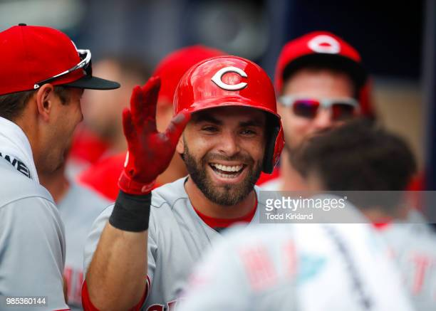 Jose Peraza of the Cincinnati Reds celebrates a home run with teammates in the third inning of an MLB game against the Atlanta Braves at SunTrust...