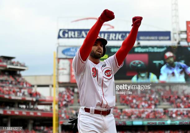 Jose Peraza of the Cincinnati Reds celebrates after hitting a three run home run in the seventh inning of the game against the Pittsburgh Pirates on...