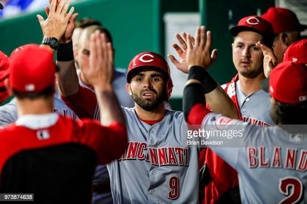 Jose Peraza of the Cincinnati Reds celebrates scoring a run against the Kansas City Royals during the seventh inning at Kauffman Stadium on June 13...