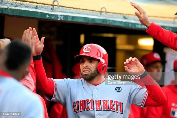 Jose Peraza of the Cincinnati Reds celebrates scoring during the second inning against the Oakland Athletics at Oakland-Alameda County Coliseum on...