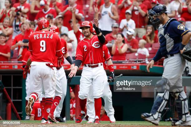 Jose Peraza of the Cincinnati Reds celebrates with Alex Blandino after hitting a grand slam home run in the sixth inning against the Milwaukee...