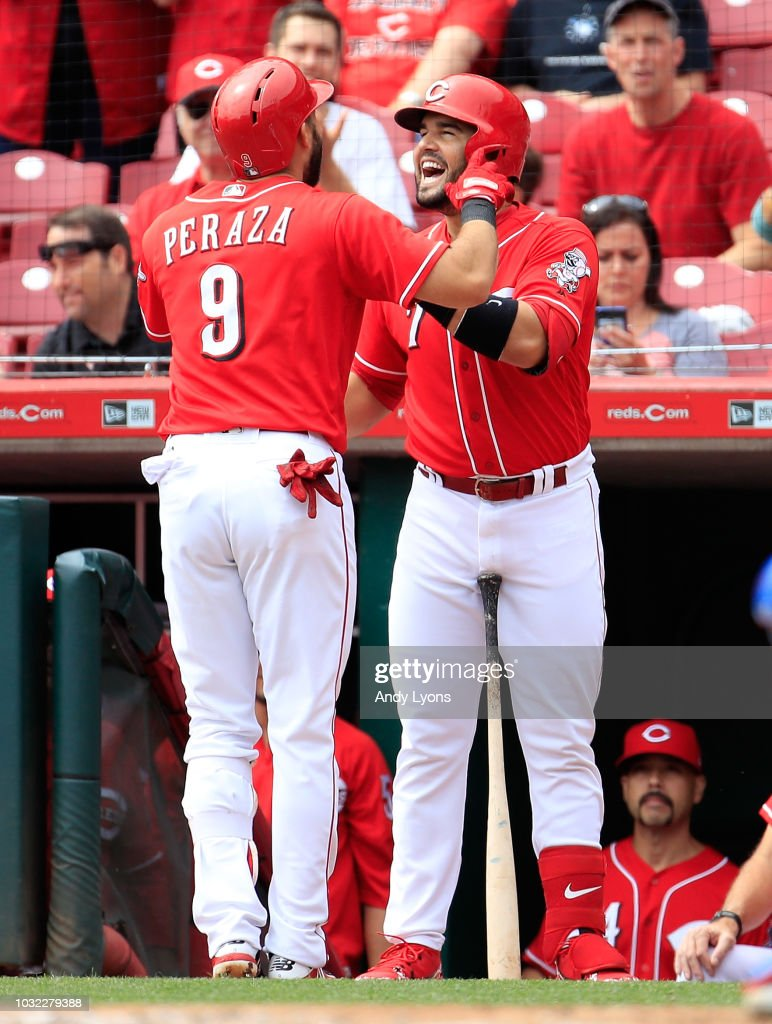 Jose Peraza #9 of the Cincinnati Reds celebrates with Eugenio Suarez #7 after hitting a home run in the first inning against the Los Angeles Dodgers at Great American Ball Park on September 12, 2018 in Cincinnati, Ohio.
