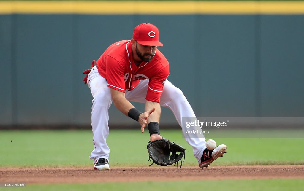 Jose Peraza #9 of the Cincinnati Reds fields a ball against the Los Angeles Dodgers at Great American Ball Park on September 12, 2018 in Cincinnati, Ohio.