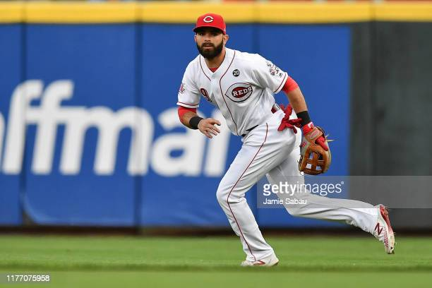 Jose Peraza of the Cincinnati Reds fields a ground ball against the Milwaukee Brewers at Great American Ball Park on September 24, 2019 in...
