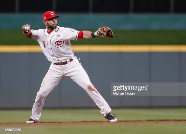 Jose Peraza of the Cincinnati Reds fields the ball during the game against the Miami Marlins at Great American Ball Park on April 9, 2019 in...