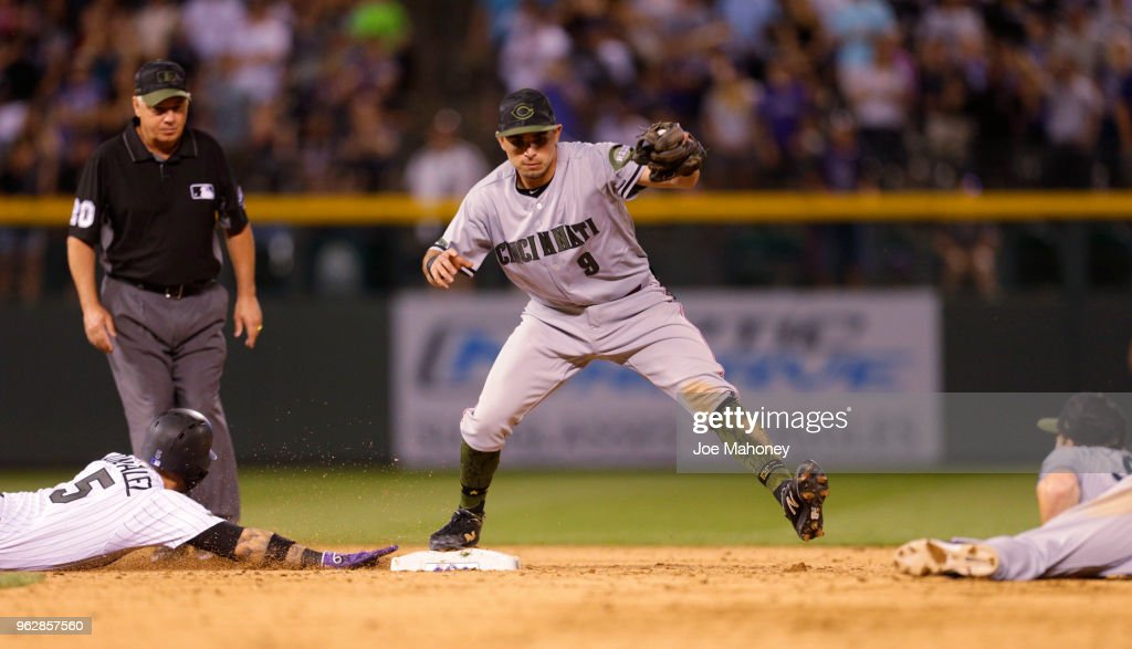 Jose Peraza #9 of the Cincinnati Reds forces out Carlos Gonzalez #5 of the Colorado Rockies at second base for the final out of the Reds 6-5 victory at Coors Field on May 26, 2018 in Denver, Colorado.
