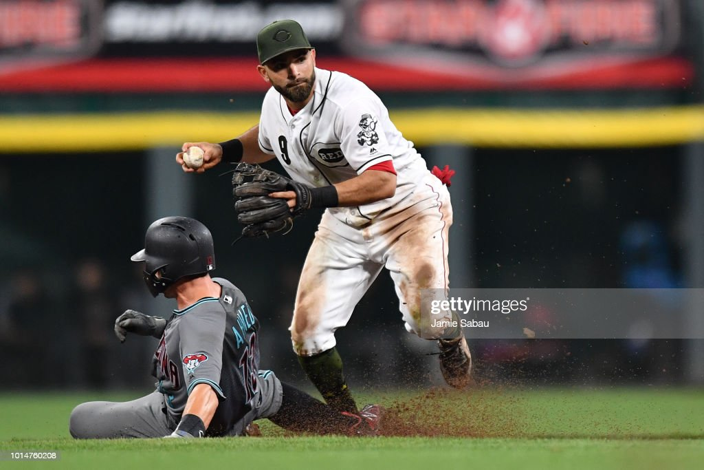Jose Peraza #9 of the Cincinnati Reds forces out Nick Ahmed #13 of the Arizona Diamondbacks at second base to begin a double play in the eighth inning at Great American Ball Park on August 10, 2018 in Cincinnati, Ohio. Cincinnati defeated Arizona 3-0.