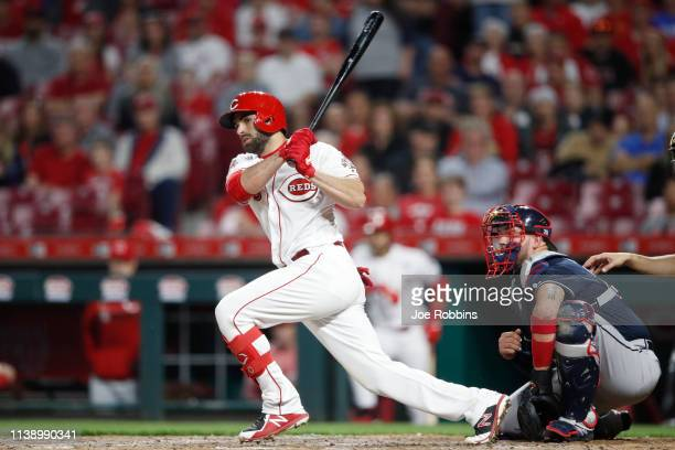 Jose Peraza of the Cincinnati Reds hits a double to left field to drive in two runs to give his team the lead in the sixth inning against the Atlanta...