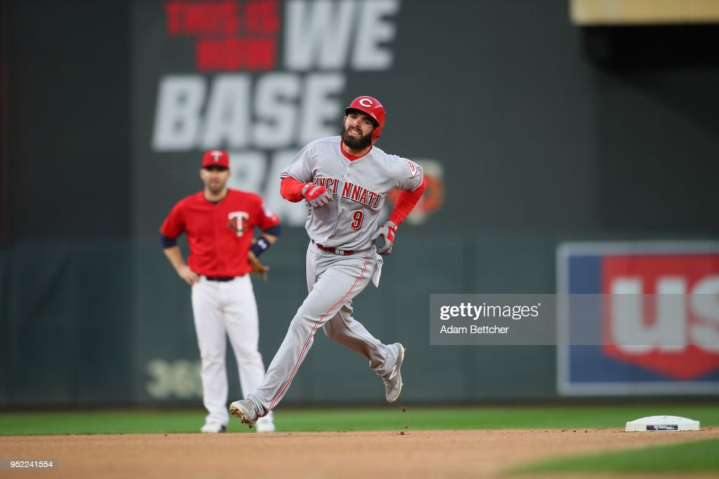 Jose Peraza #9 of the Cincinnati Reds hits a home run against the Minnesota Twins in the first inning at Target Field on April 27, 2018 in Minneapolis, Minnesota.