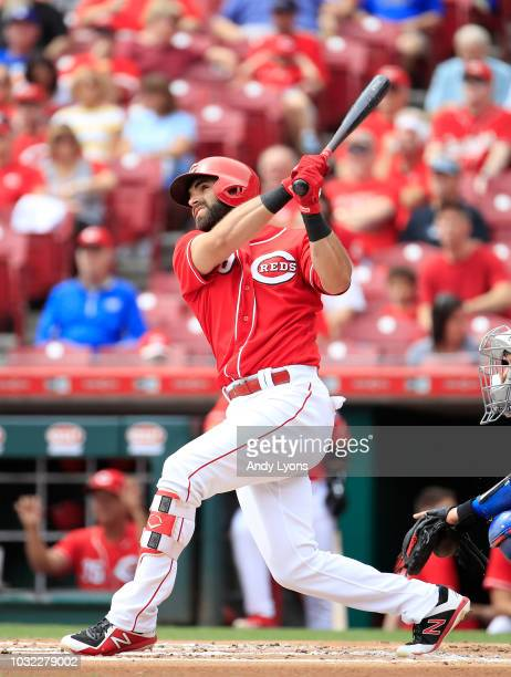 Jose Peraza of the Cincinnati Reds hits a home run in the first inning against the Los Angeles Dodgers at Great American Ball Park on September 12,...