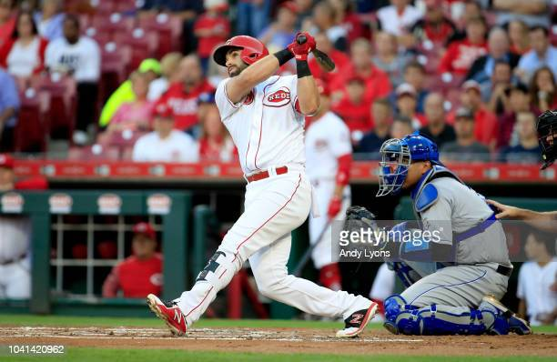 Jose Peraza of the Cincinnati Reds hits a home run in the first inning against the Kansas City Royals at Great American Ball Park on September 26,...