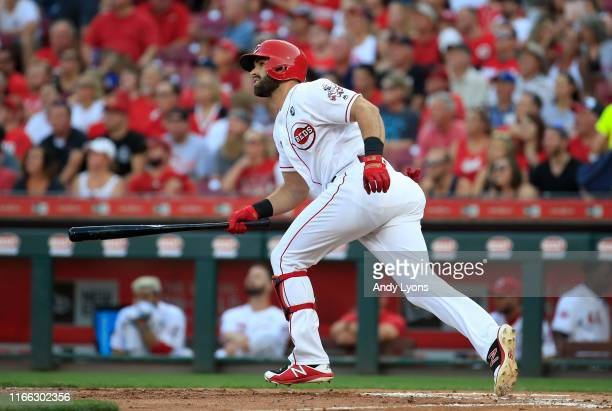 Jose Peraza of the Cincinnati Reds hits a RBI double in the first inning against the Los Angeles Angels of Anaheim at Great American Ball Park on...