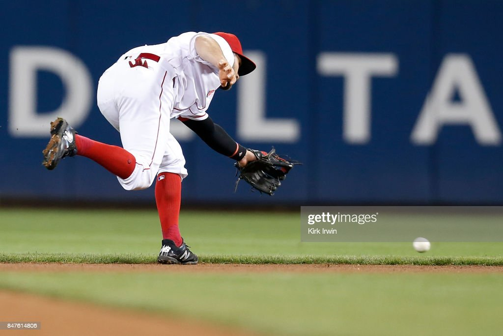 Jose Peraza #9 of the Cincinnati Reds is unable to make a play on a ground ball hit by David Freese #23 of the Pittsburgh Pirates during the fourth inning at Great American Ball Park on September 15, 2017 in Cincinnati, Ohio. Cincinnati defeated Pittsburgh 4-2.