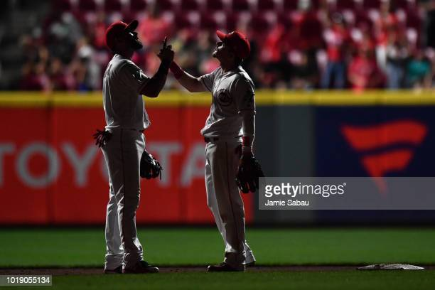 Jose Peraza of the Cincinnati Reds, left, and Scooter Gennett of the Cincinnati Reds celebrate after the Reds defeated the San Francisco Giants 7-1...
