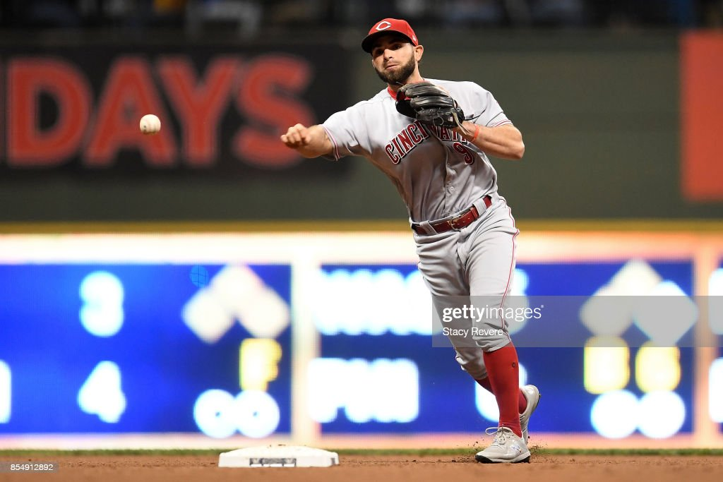 Jose Peraza #9 of the Cincinnati Reds makes a throw to first base during the fifth inning of a game against the Milwaukee Brewers at Miller Park on September 27, 2017 in Milwaukee, Wisconsin.