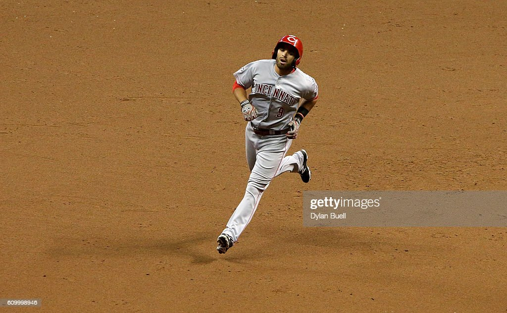 Jose Peraza #9 of the Cincinnati Reds rounds the bases after hitting a home run in the fifth inning against the Milwaukee Brewers at Miller Park on September 23, 2016 in Milwaukee, Wisconsin.