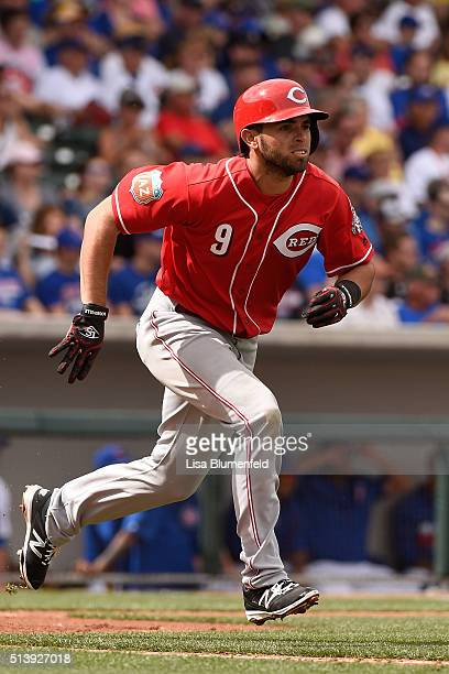 Jose Peraza of the Cincinnati Reds runs to first base against the Chicago Cubs on March 5, 2016 in Mesa, Arizona.
