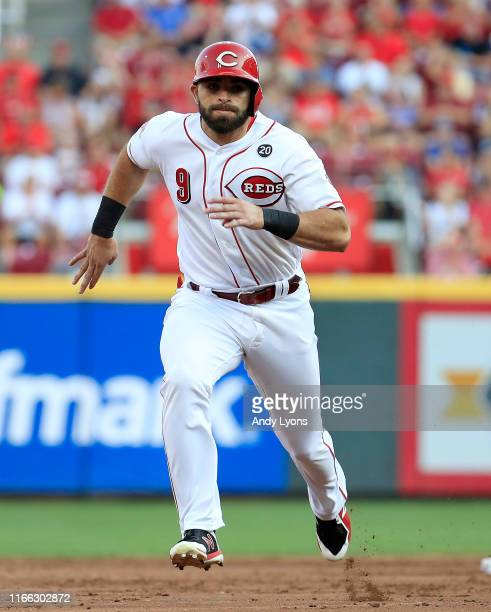 Jose Peraza of the Cincinnati Reds runs to third base in the first inning against the Los Angeles Angels of Anaheim at Great American Ball Park on...
