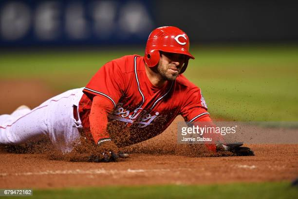 Jose Peraza of the Cincinnati Reds slides in to third base for a three-run triple in the fourth inning against the San Francisco Giants at Great...