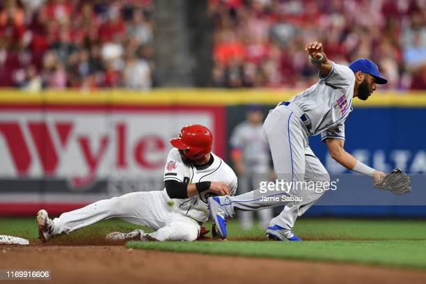 Jose Peraza of the Cincinnati Reds steals second base in the third inning as Amed Rosario of the New York Mets takes the wide throw at Great American...