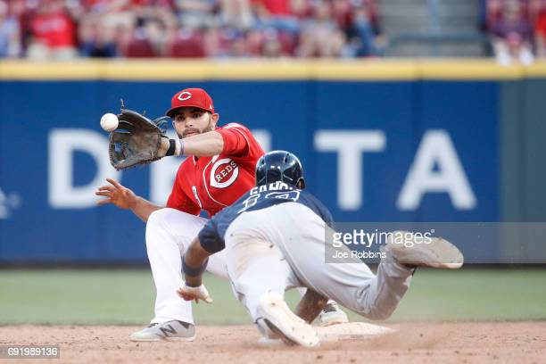 Jose Peraza of the Cincinnati Reds takes the throw at second base for a double play ahead of the diving Adonis Garcia of the Atlanta Braves in the...