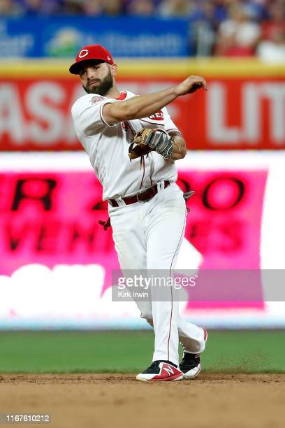 Jose Peraza of the Cincinnati Reds throws the ball to first base during the game against the Chicago Cubs at Great American Ball Park on August 10,...