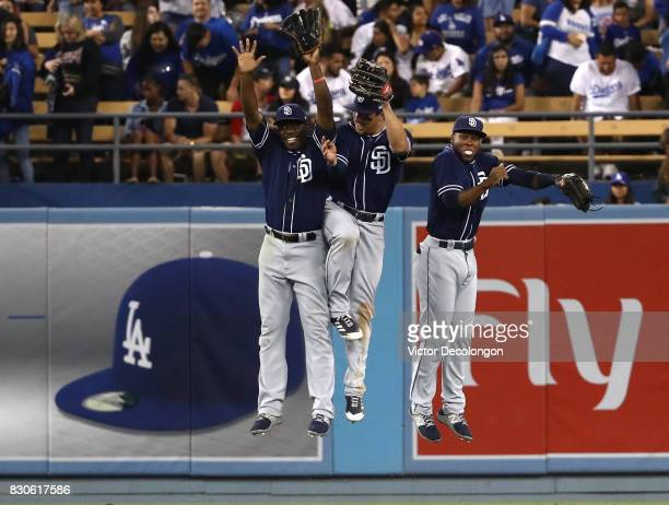 Jose Pirela Hunter Renfroe and Manuel Margot of the San Diego Padres celebrate in the outfield after their 43 win against the Los Angeles Dodgers in...