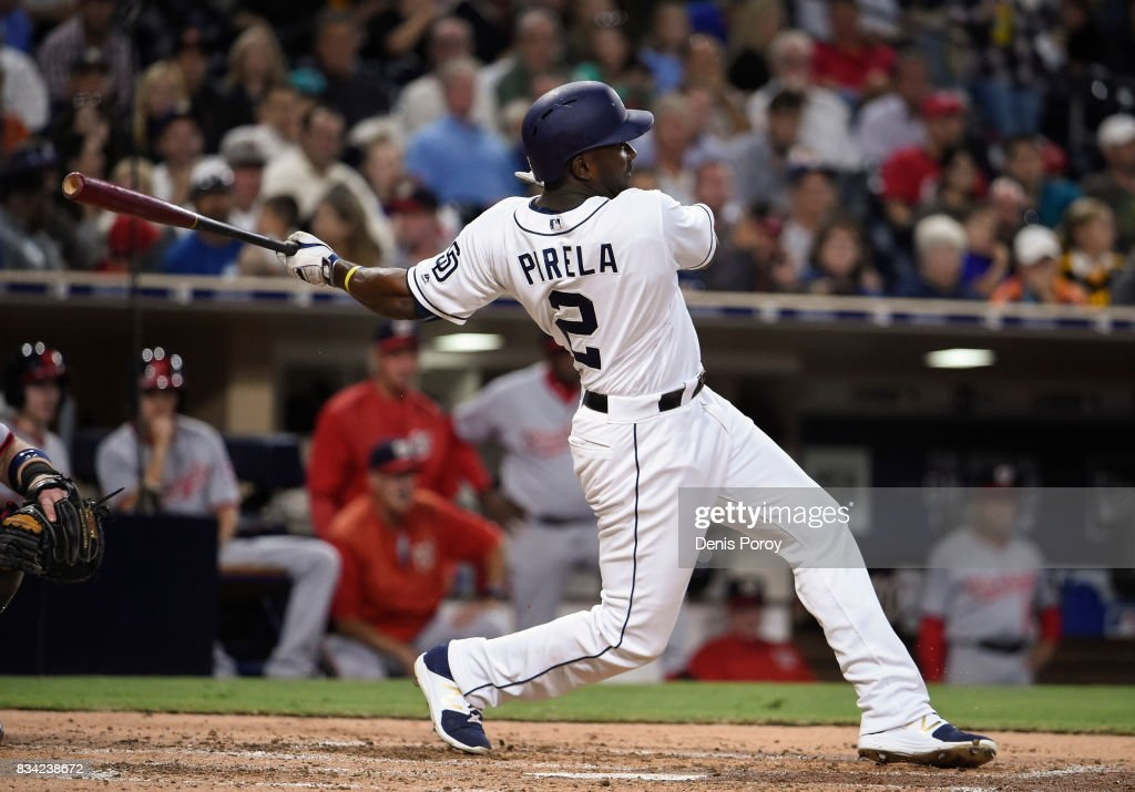 Jose Pirela #2 of the San Diego Padres hits an RBI single during the third inning of a baseball game against the Washington Nationals at PETCO Park on August 17, 2017 in San Diego, California.