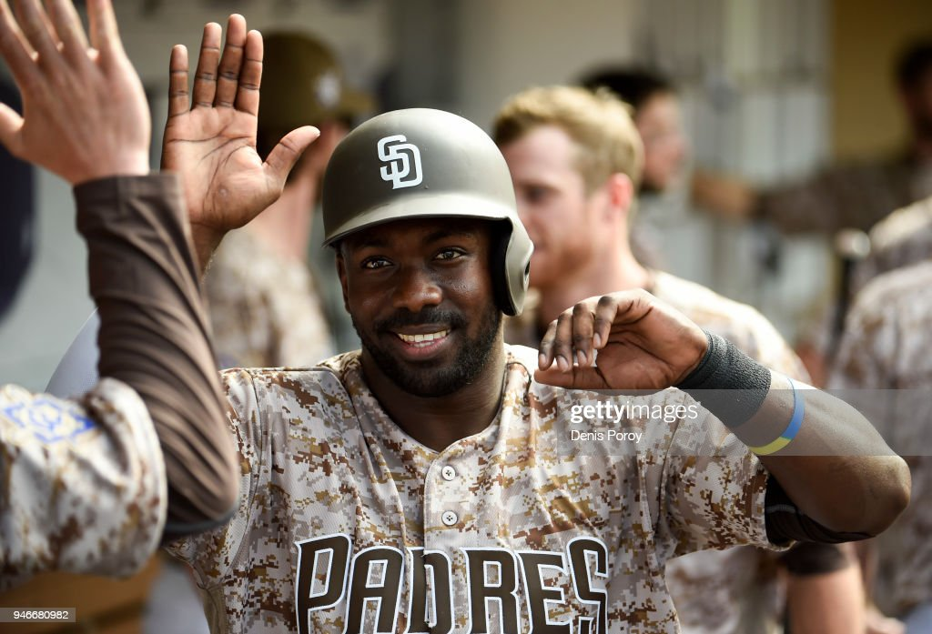 Jose Pirela #2 of the San Diego Padres is congratulated after scoring during the seventh inning of a baseball game against the San Francisco Giants at PETCO Park on April 15, 2018 in San Diego, California. All players are wearing #42 in honor of Jackie Robinson Day.