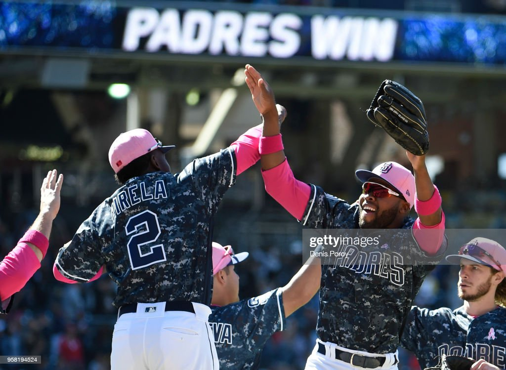 Jose Pirela #2 of the San Diego Padres, left, and Manuel Margot #7 celebrate after beating the St. Louis Cardinals 5-3 in a baseball game at PETCO Park on May 13, 2018 in San Diego.