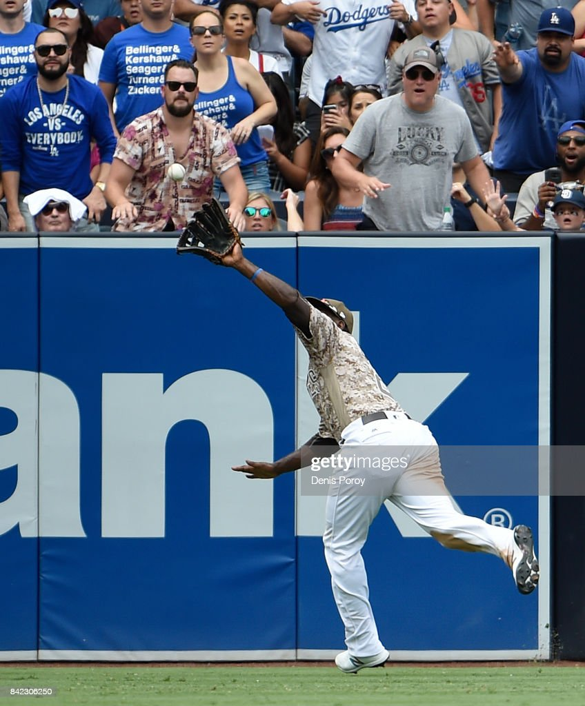 Jose Pirela #2 of the San Diego Padres makes a running catch on a ball hit by Yasiel Puig #66 of the Los Angeles Dodgers during the fourth inning of a baseball game at PETCO Park on September 3, 2017 in San Diego, California.