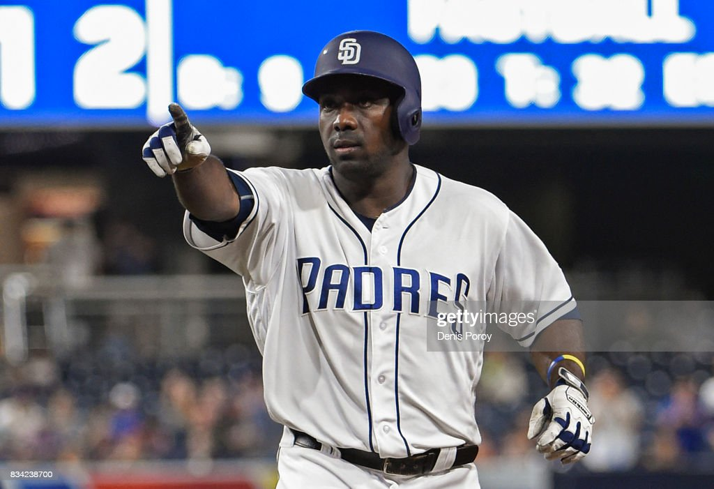 Jose Pirela #2 of the San Diego Padres points back to the dugout after hitting an RBI single during the third inning of a baseball game against the Washington Nationals at PETCO Park on August 17, 2017 in San Diego, California.