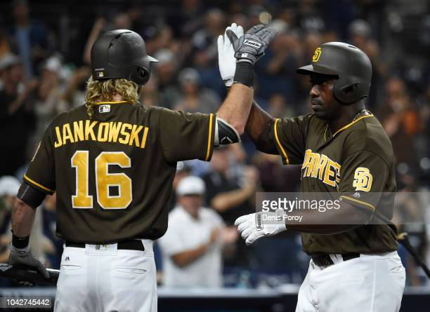 Jose Pirela of the San Diego Padres, right, is congratulated by Travis Jankowski after hitting a solo home run during the seventh inning of a...